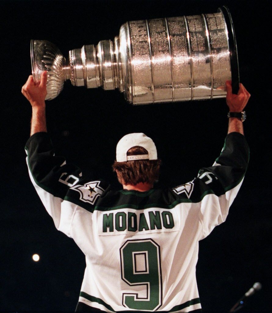 Dallas Stars' Mike Modano hoists the Stanley Cup over his head during a ceremony at Reunion Arena after the Stars victory parade in downtown Dallas on Monday.