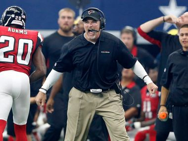 Atlanta Falcons head coach Dan Quinn celebrates after his defense sacked Dallas Cowboys quarterback Brandon Weeden (3) to force Dallas to punt during the second half of play at AT&T Stadium in Arlington on Sunday, September 27, 2015. Atlanta Falcons defeated the Dallas Cowboys 39-28.