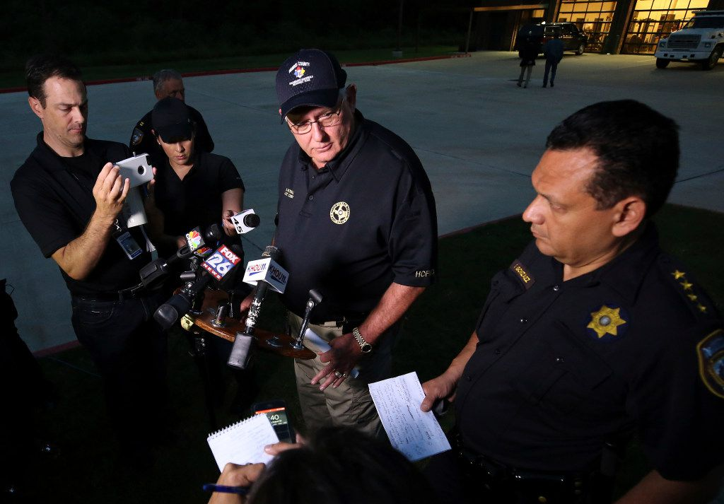 Harris County Fire Marshal Assistant Chief Bob Royall, center, and Harris County Sheriff Ed Gonzalez speak about the explosion of organic peroxides at the Arkema chemical plant during a press conference outside the Crosby Fire Department Thursday, Aug. 31, 2017, in Crosby, Texas. Fifteen Harris County Sheriff Office deputies that first responded to the fire at the plant were sent to the hospital and later released.