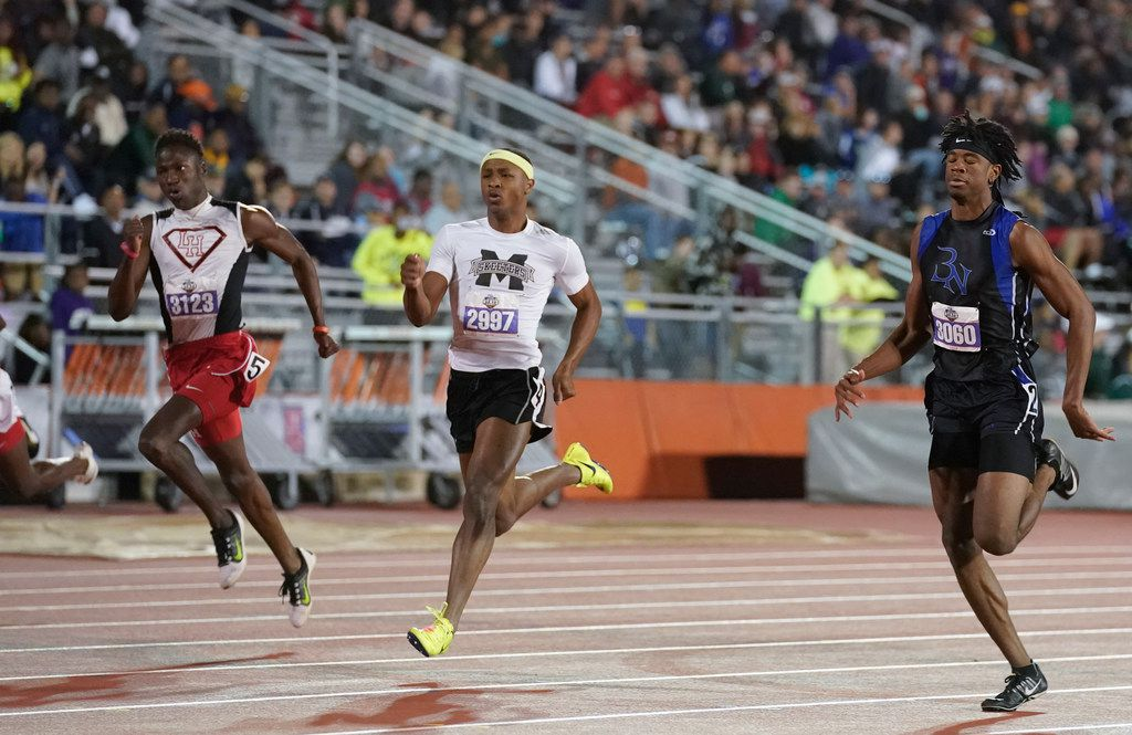 Caleb Boger (2997) of Mesquite powers his way to a third place finish in the boys 6A 200-meter dash at the UIL State Championships in Austin on May 11, 2019.  Boger had a time of 21.10 seconds and is flaned by Ismael Kobe, (3123) of Rice Lake and Calvin Wiggins of NW Nelson. (Bob Daemmrich/SPecial Contributor)