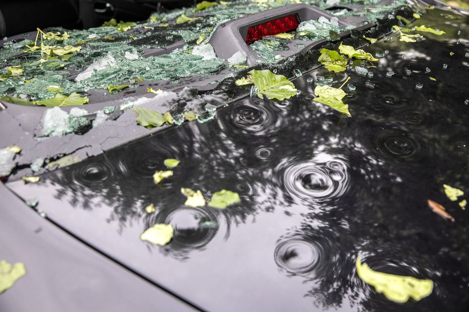 A vehicle sustained significant window damage and dents in a severe hailstorm overnight in Keller, Texas, on Thursday, April 29, 2021. Areas of North Texas experienced severe storms, some with reported baseball-sized hail. (Lynda M. González/The Dallas Morning News)