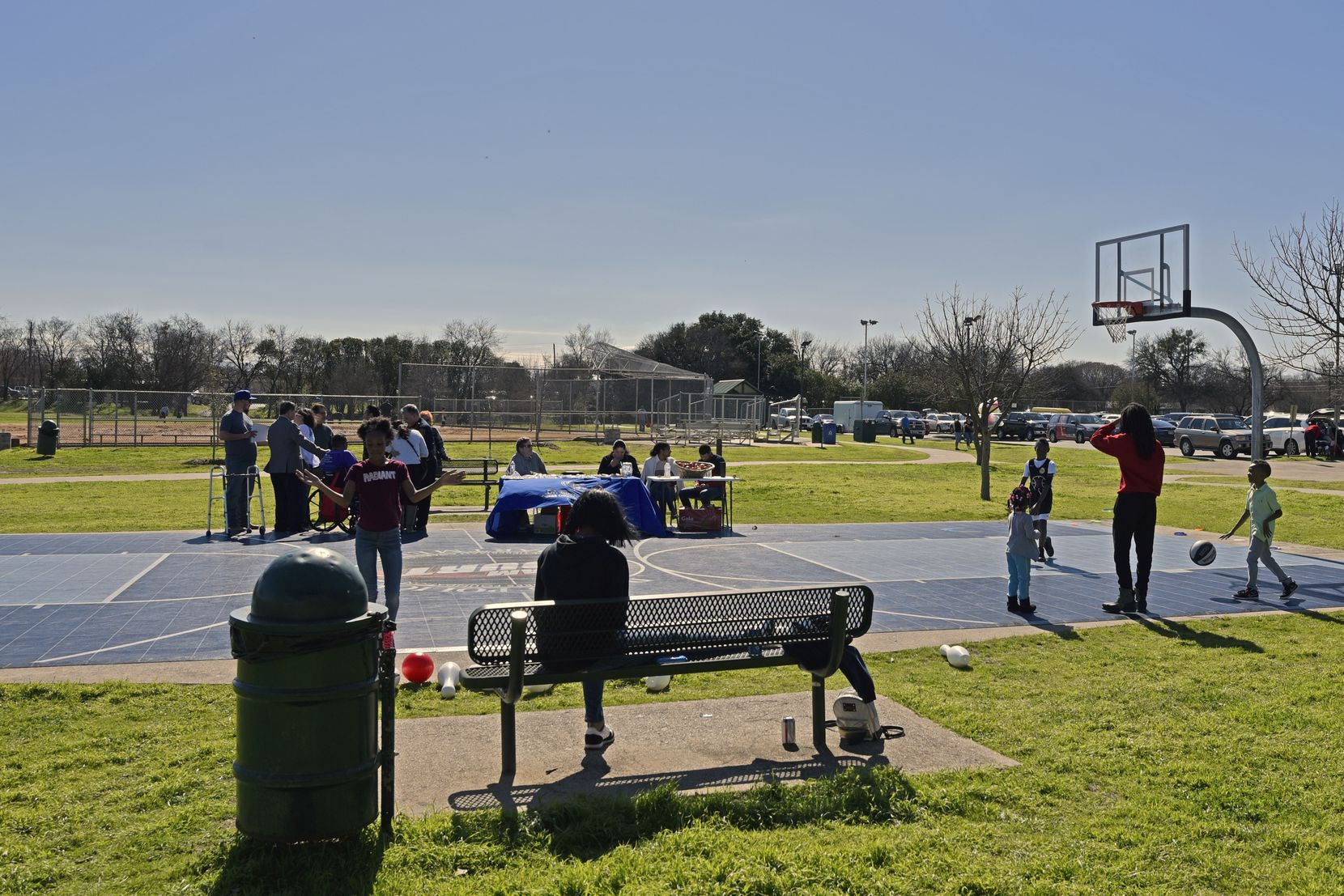 Kids play basketball during the Census Fun Day at Jaycee Zaragoza Park Pavilion in Dallas, Feb. 08, 2020.