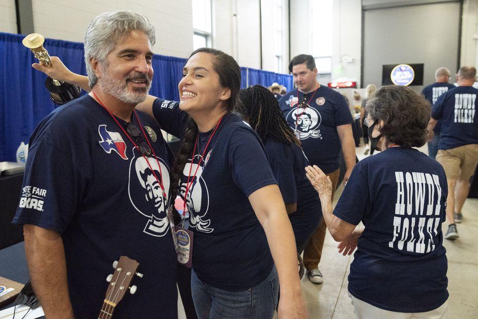 "James Barrera, left, and his daughter Cherish Maldonado Barrera celebrate backstage after winning the award ""best taste"" for their dessert The Armadillo."