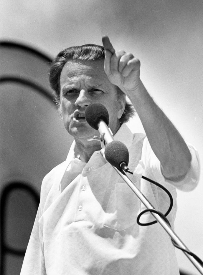"""Speaking to the massive Jesus music rally on the  Woodall-Rodgers Freeway, the grand finale of the 6-day spiritual congress Explo '72, evangelist Billy Graham continued to expound on the message that has been interwoven throughout the convention, that """"hearts must be changed before problems can be solved."""""""