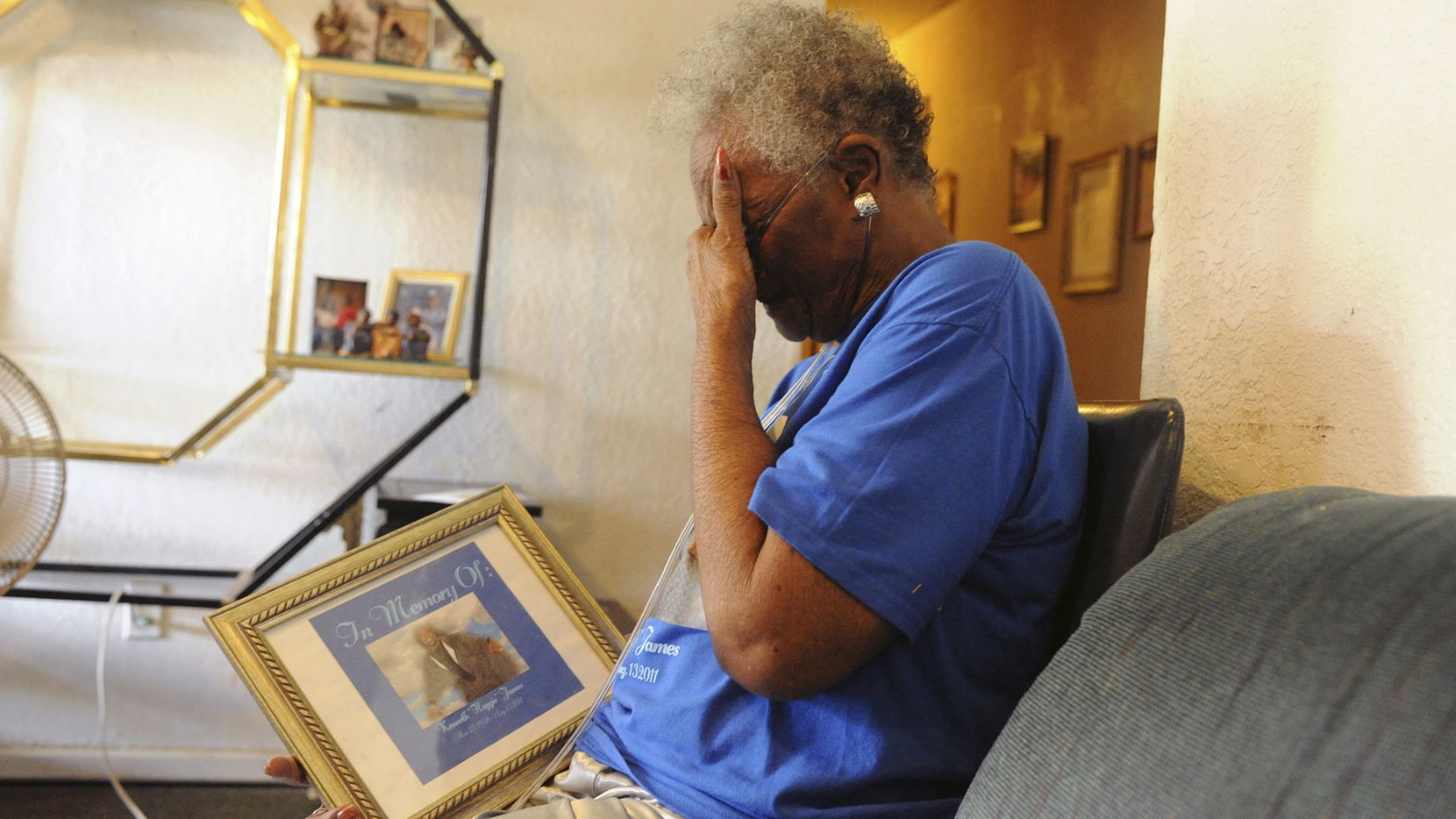 Mary Lou James cries as she looks at the photograph of her deceased son Kenneth Wayne James, who was found in his prison cell with a body temperature of 108 degrees, at her home in Lubbock, Texas, July 25, 2012. Prisoners' rights advocates believe that the lack of air-conditioning in most Texas state prisons puts inmatesÕ lives at risk. (David Bowser/The New York Times) 07292012xNEWS