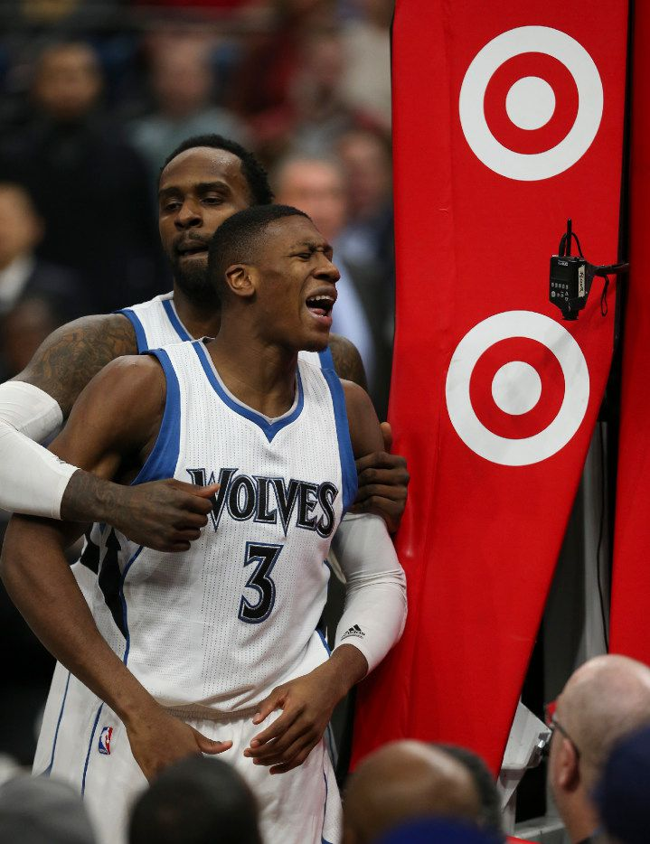 Minnesota Timberwolves guard Kris Dunn is restrained by teammate Shabazz Muhammad after Dunn was fouled flagrantly by Justin Anderson on Monday. (Jeff Wheeler/Minneapolis Star Tribune/TNS)