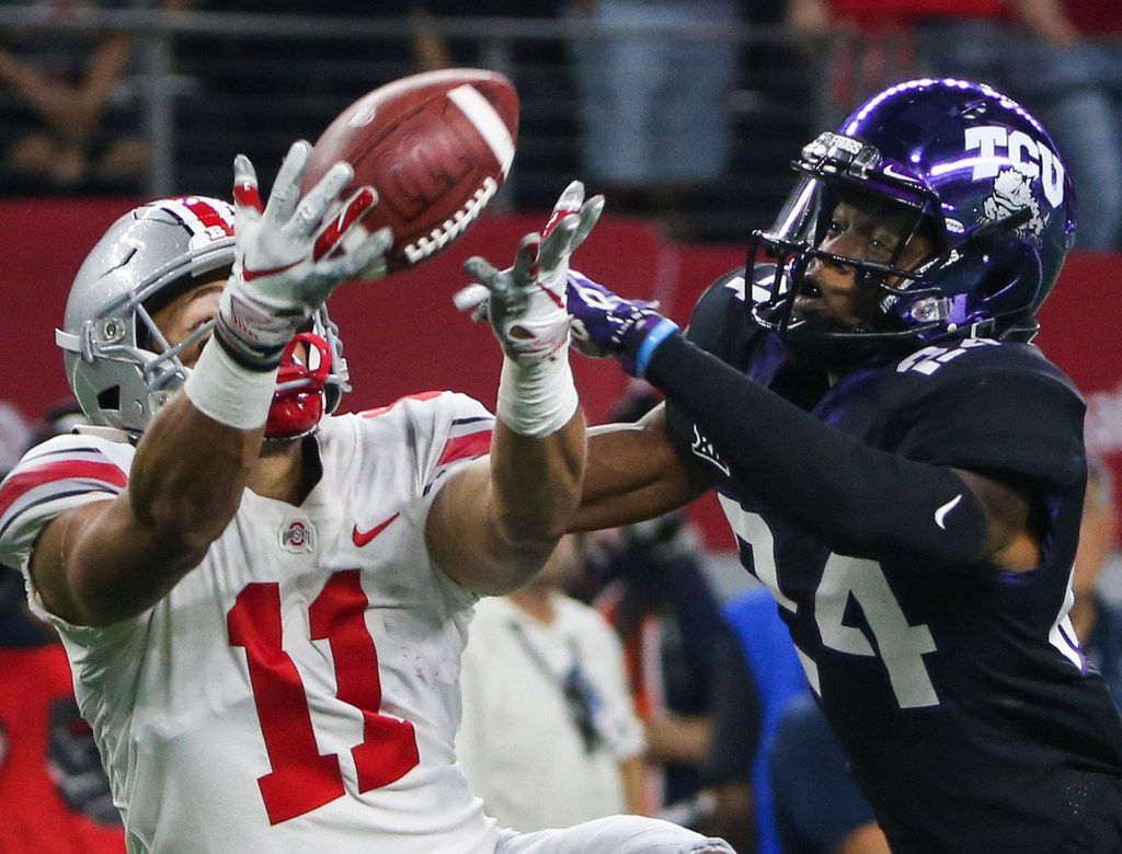 FILE - Ohio State Buckeyes wide receiver Austin Mack (11) reaches to receive a pass around TCU cornerback Julius Lewis (24) during the AdvoCare Showdown between the Ohio State Buckeyes and the Texas Christian University Horned Frogs on Saturday, Sept. 15, 2018 at AT&T Stadium in Arlington, Texas. (Ryan Michalesko/The Dallas Morning News)