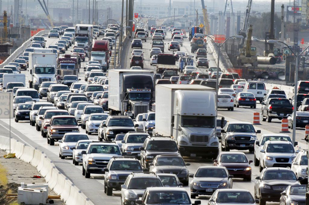 Traffic moves slow and heavy on LBJ Freeway between Webb Chapel and Marsh Lane in Dallas. (File Photo/Staff)