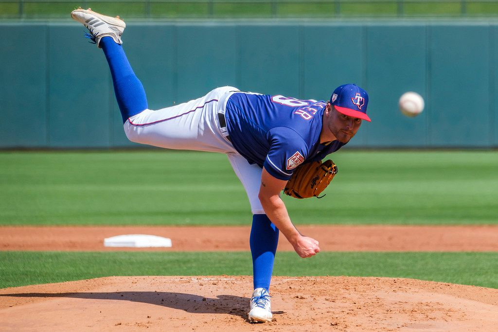 Texas Rangers pitcher Shelby Miller pitches during the first inning of a spring training baseball game against the Chicago White Sox on Friday, March 1, 2019, in Surprise, Ariz.. (Smiley N. Pool/The Dallas Morning News)