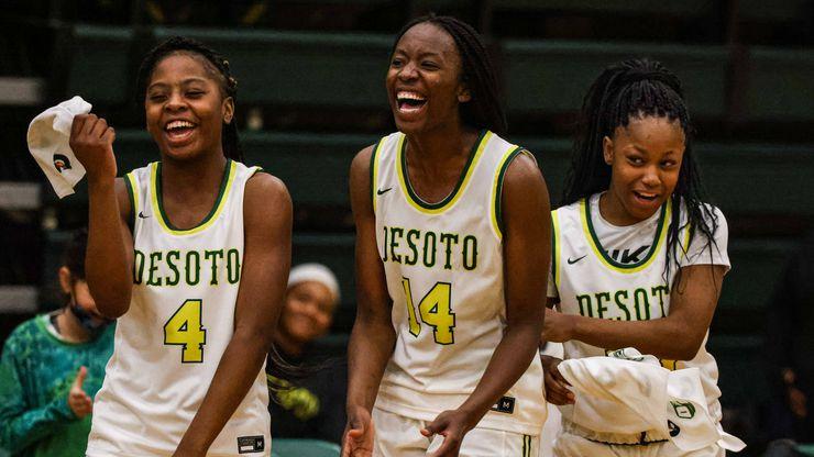 DeSoto's Ja'Mia Harris (4), Amina Muhammad (14) and Miah Payton (10) celebrate during Saturday's 69-60 win over Duncanville. (Lola Gomez/The Dallas Morning News)