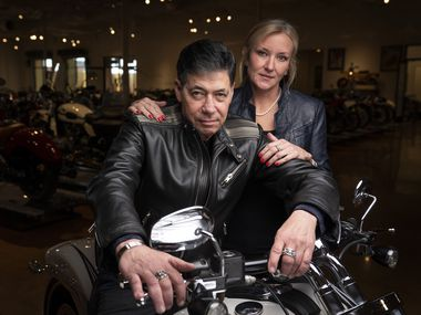 """Dallas financier Bobby Haas poses with partner and museum director Stacey Mayfield in the main exhibit hall of his Haas Moto Museum & Sculpture Gallery in the Design District in Dallas. Haas has made a documentary film called """"Leaving Tracks"""" about the world of rare and custom motorcycles."""