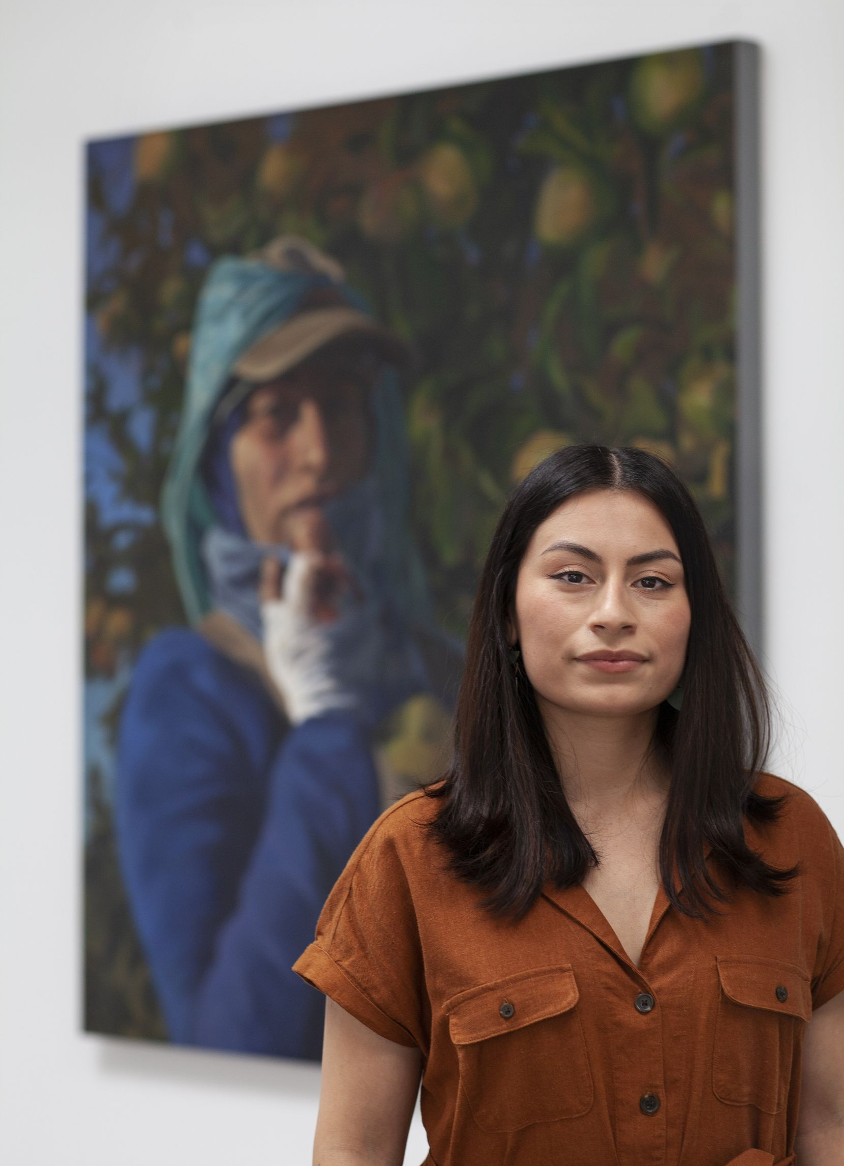 Artist Arely Morales with her painting 'Maria,' 2017, oil on canvas. Photograph by Nan Coulter/Special Contributor.