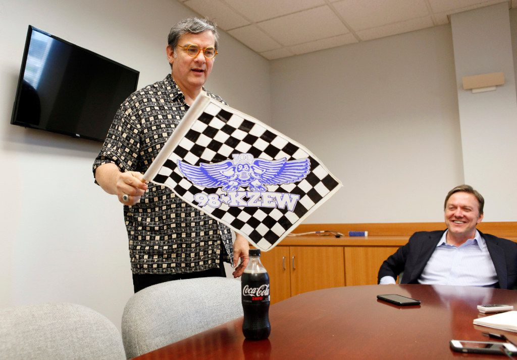 George Gimarc brought in one of his old KZEW keepsakes -- appropriately, a checkered flag -- during a sitdown with Vokal's COO Thursday, March 23, 2017.  (Ben Torres/Special Contributor)