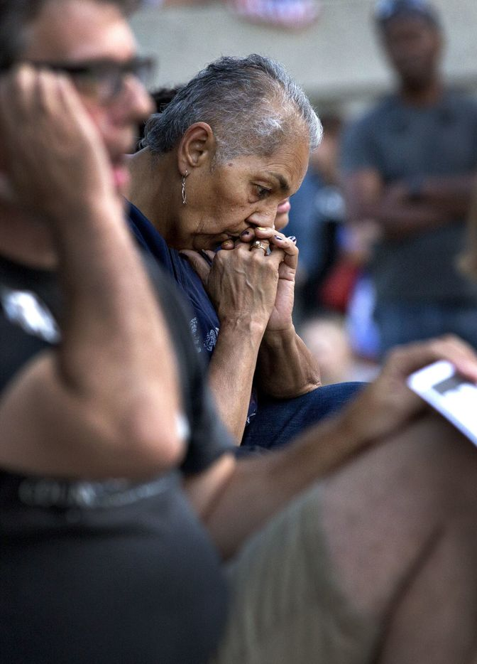 Greensboro City Councilwoman Yvonne Johnson listens in Greensboro, N.C., Sunday, Aug. 13, 2017, during a rally to mourn the violence in Charlottesville, Va.