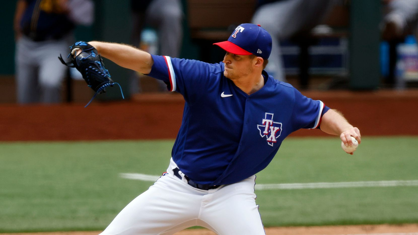 Texas Rangers relief pitcher Wes Benjamin (63) throws against the Milwaukee Brewers in the seventh inning at Globe Life Field in Arlington, Texas. The teams were playing in an exhibition game, Tuesday, March 30, 2021. (Tom Fox/The Dallas Morning News)
