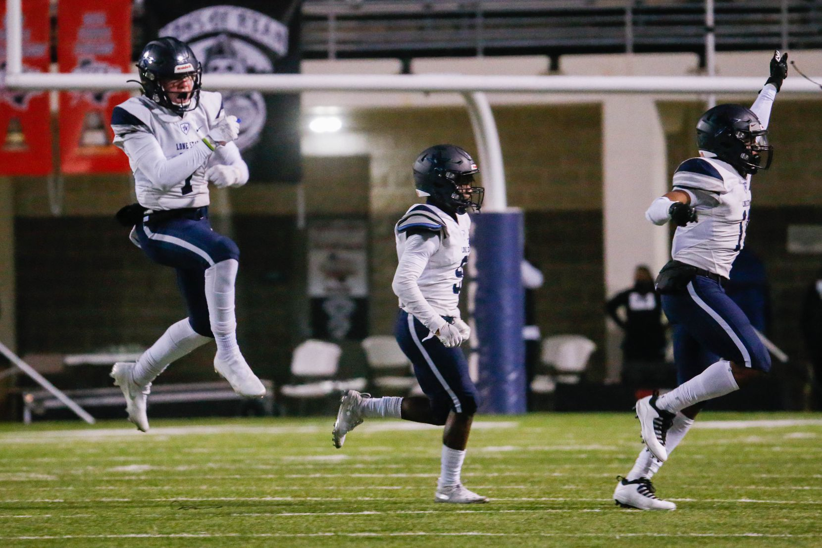 Frisco Lone Star defensive players celebrate a recovered fumble during the second quarter of a football game against Denton Ryan at the C.H. Collins Complex in Denton on Thursday, Dec. 4, 2020. The game is tied at halftime, 14-14. (Juan Figueroa/ The Dallas Morning News)
