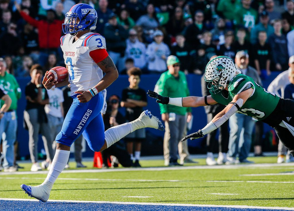 Duncanville quarterback JaÕQuinden Jackson (3) walks in a touchdown past Southlake defensive back Beck Para during the first half of a Class 6A Division I Region I high school football matchup between Southlake Carroll and Duncanville on Saturday, Dec. 7, 2019 at McKinney ISD Stadium in McKinney, Texas. (Ryan Michalesko/The Dallas Morning News)