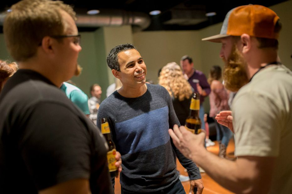 Nathan Hanks, CEO and co-founder of MAX (center), chats with fans at a private meet-and-greet at a Needtobreathe concert. MAX matched the Christian rock band to Dr. Pepper for ad campaigns.