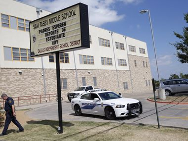 Dallas ISD police outside Tasby Middle School in 2014 as they patrolled the campus' main entrance.