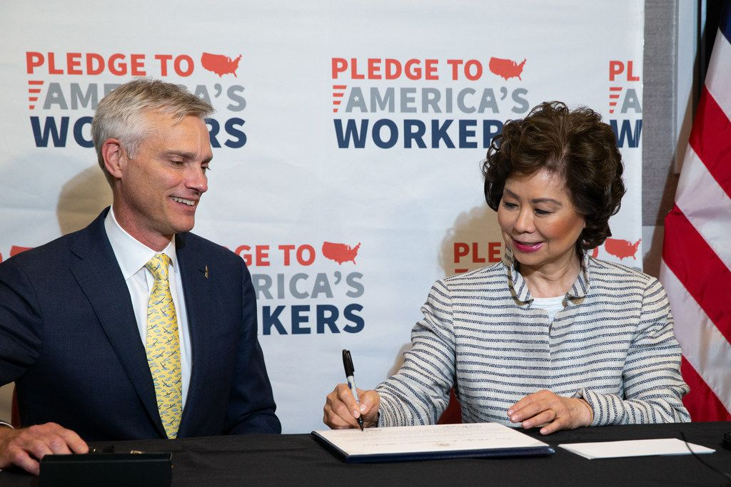 U.S. Transportation Secretary Elaine Chao (right) joins American Airlines President Robert Isom as the airline signed on to the White House's Pledge to America's Workers by committing to create 22,000 training and education opportunities.