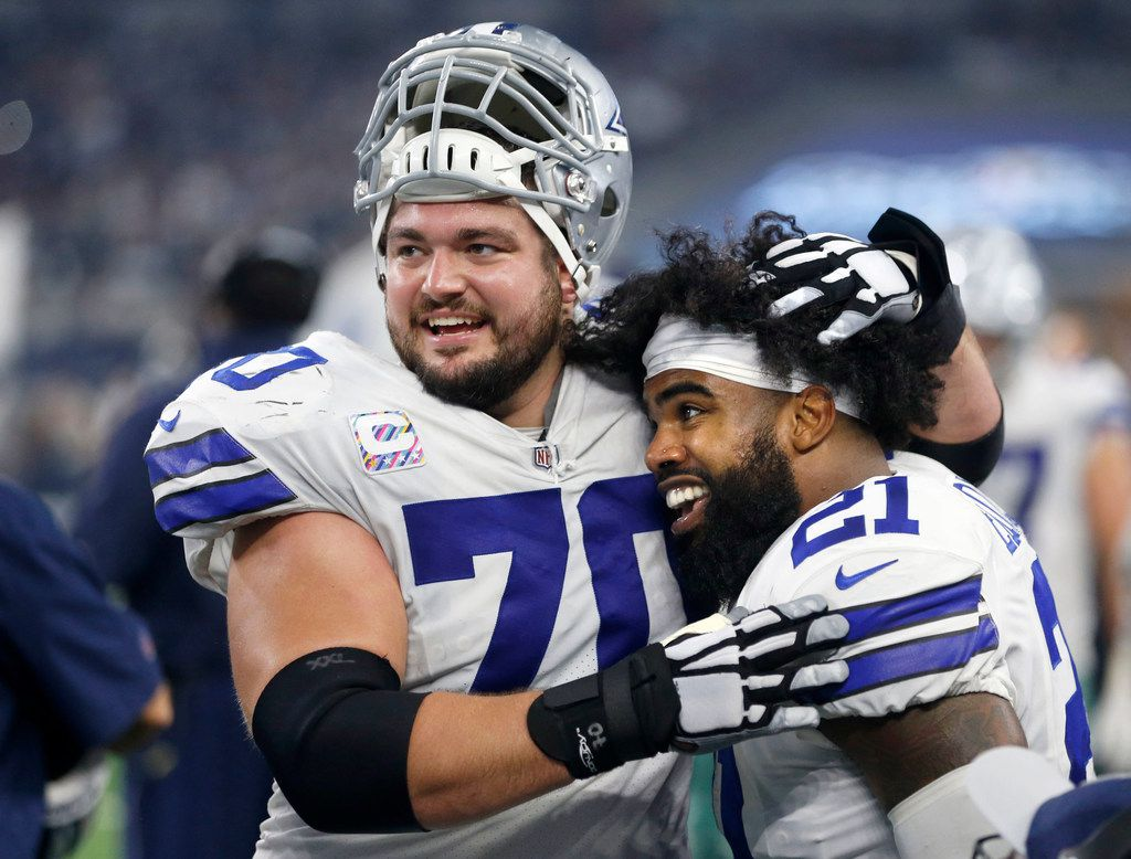 Dallas Cowboys running back Ezekiel Elliott (21) and Dallas Cowboys offensive guard Zack Martin (70) celebrate after an Elliott rushing touchdown in a game against the Jacksonville Jaguars during the second half of play at AT&T Stadium in Arlington, Texas on Sunday, October 14, 2018. Dallas Cowboys defeated the Jacksonville Jaguars 40-7. (Vernon Bryant/The Dallas Morning News)