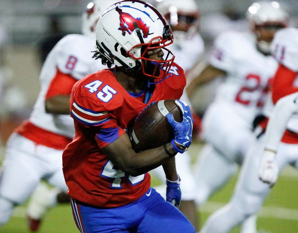 J.J. Pearce High School running back Dequan Landon (45) carries the ball during the first half as J.J. Pearce High School hosted Skyline High School at Eagle/Mustang Stadium in Richardson on Friday night, November 8, 2019. (Stewart F. House/Special Contributor)
