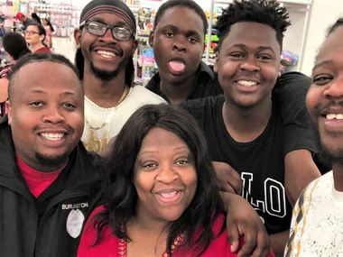 Clarkster Toure, a Mesquite ISD school bus driver who died of COVID-19, is shown with her five sons.