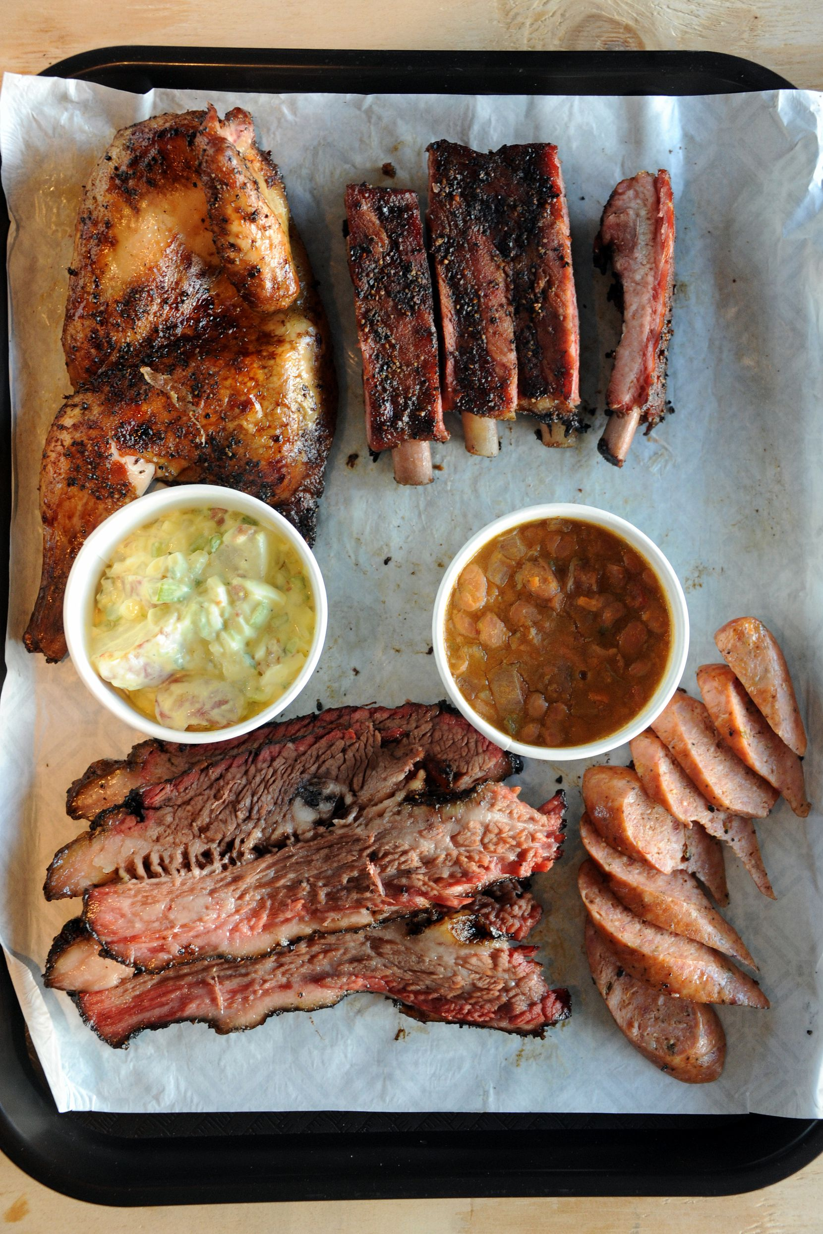Guests can choose from brisket, chicken, ribs, sausage and turkey with sides like potato salad, beans, coleslaw and mac n' cheese at Ten 50 BBQ.