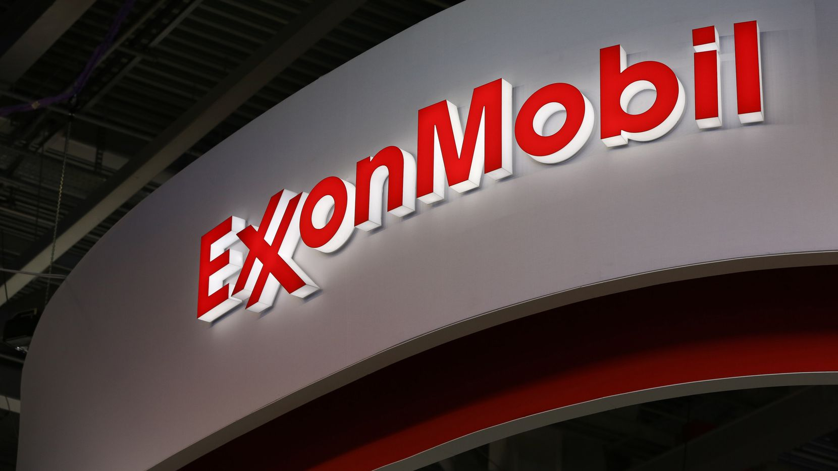 A logo sits illuminated outside the Exxon Mobil Corp. corporate pavilion during the 21st World Petroleum Congress in Moscow, Russia, on Monday, June 16, 2014. (Andrey Rudakov/Bloomberg)