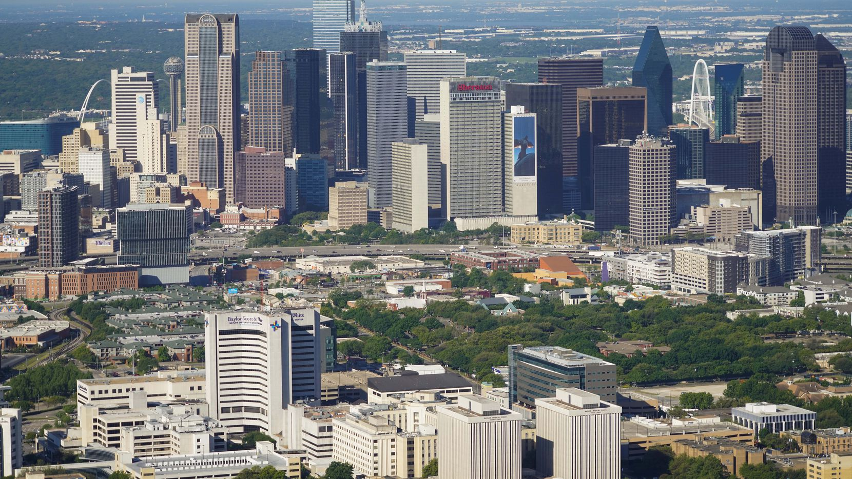 An aerial view of the downtown Dallas skyline with the Baylor University Medical Center in the foreground.