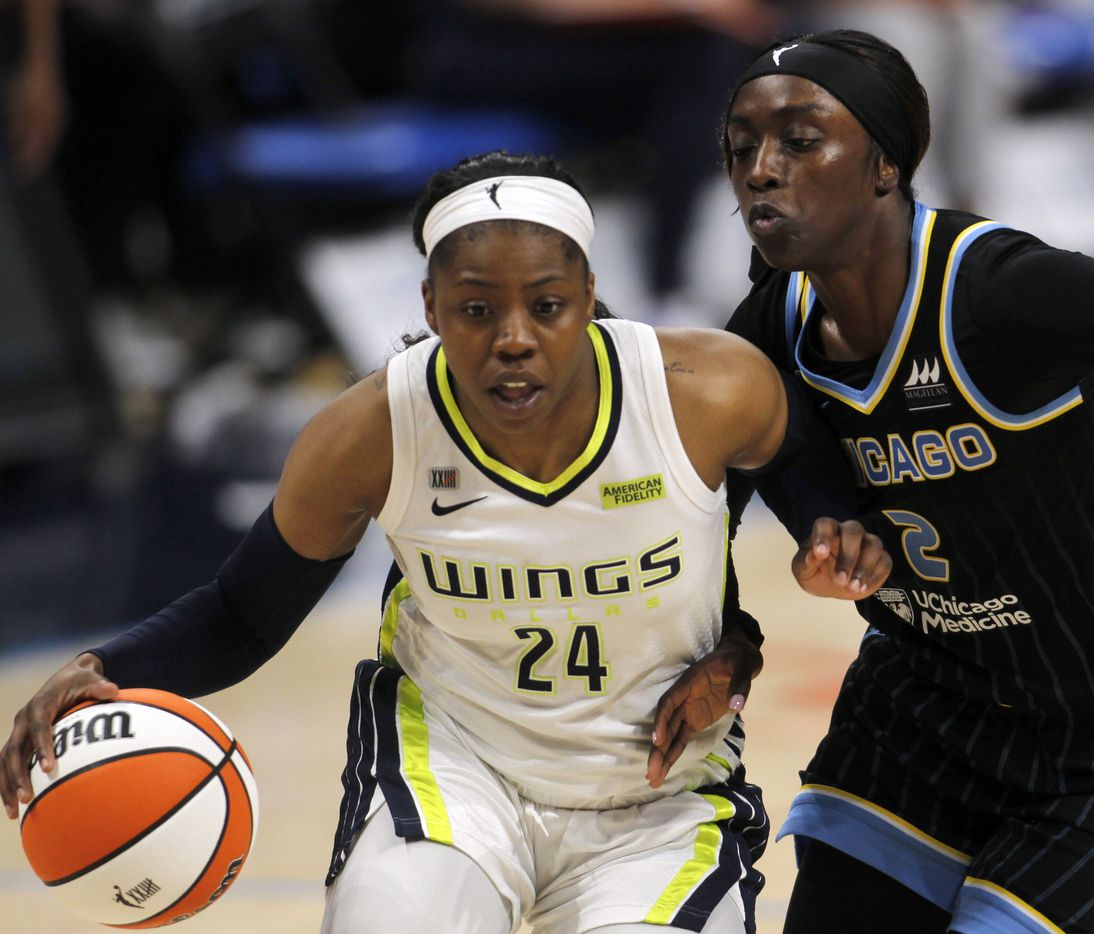 Dallas Wings guard Arike Ogunbowale (24) drives past the defense of the Chicago Sky guard Kahleah Copper (24) during second half action. Dallas defeated Chicago 100-91.The two WNBA teams played their game at College Park Center in Arlington on July 2, 2021. (Steve Hamm/ Special Contributor)