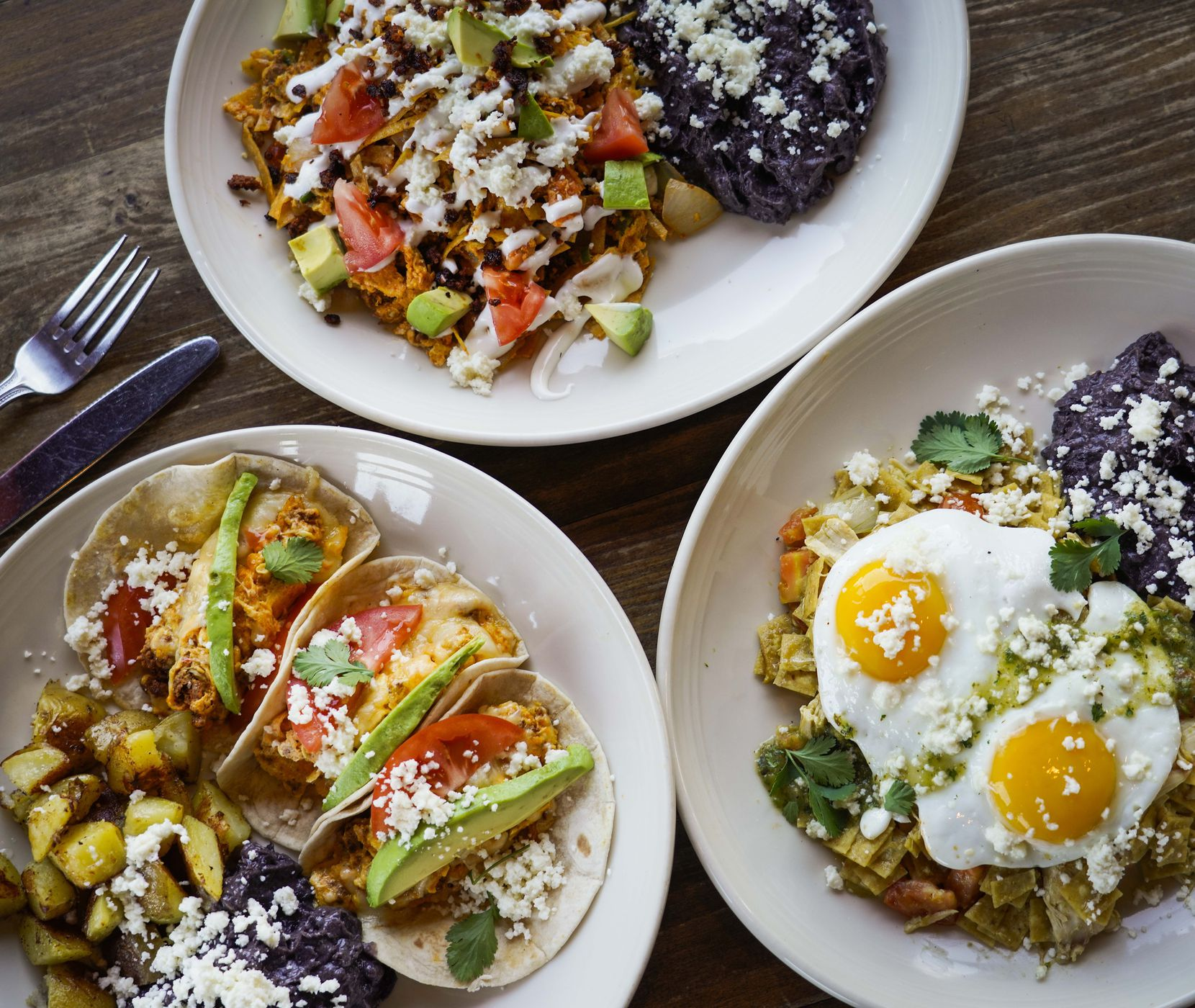 Chorizo migas (top), chilaquiles verdes (right) and chorizo eggs and cheese tacos are among the weekend brunch Easter specials at Meso Maya, photographed on March 26, 2020, in Dallas.