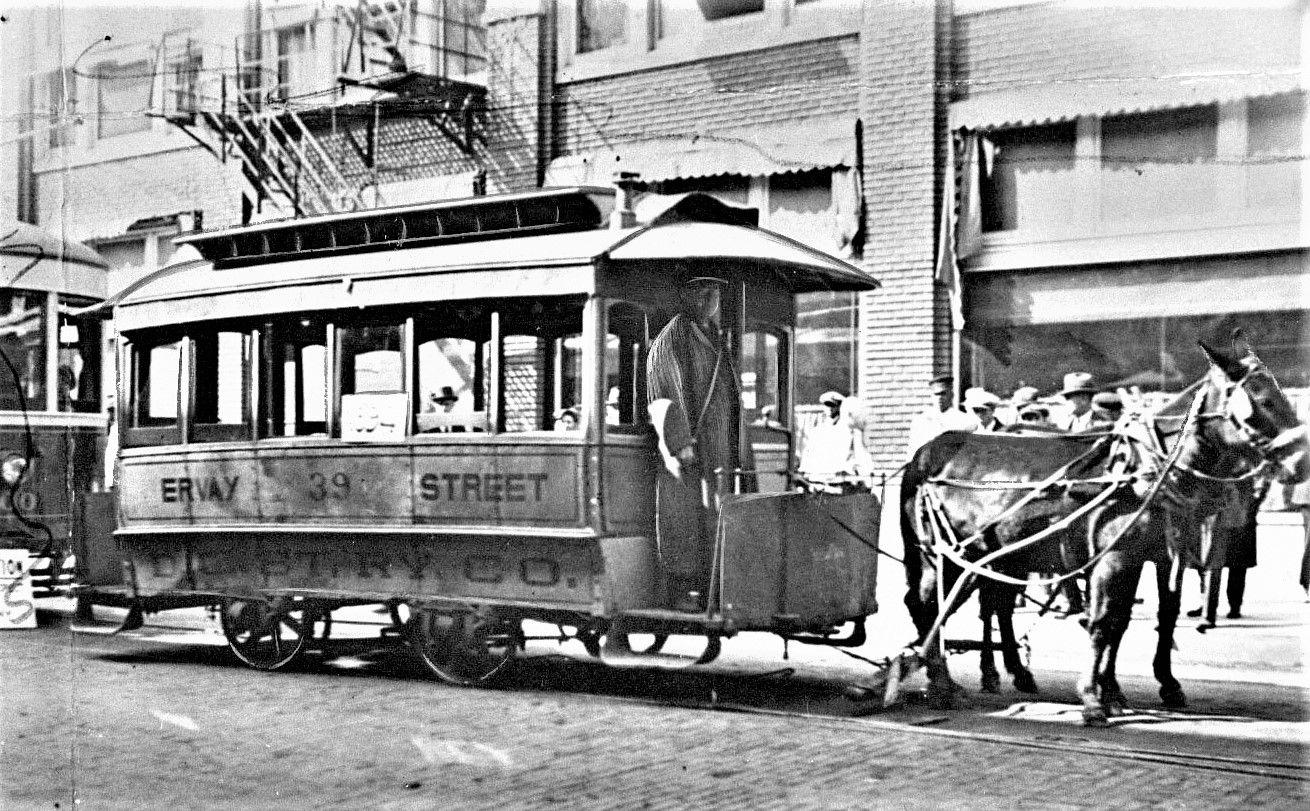 Mule-drawn streetcars, like this one on Ervay Street, were once a common sight around Dallas. Mules were more well-suited than horses for the task as the former stood up better to the Texas heat.