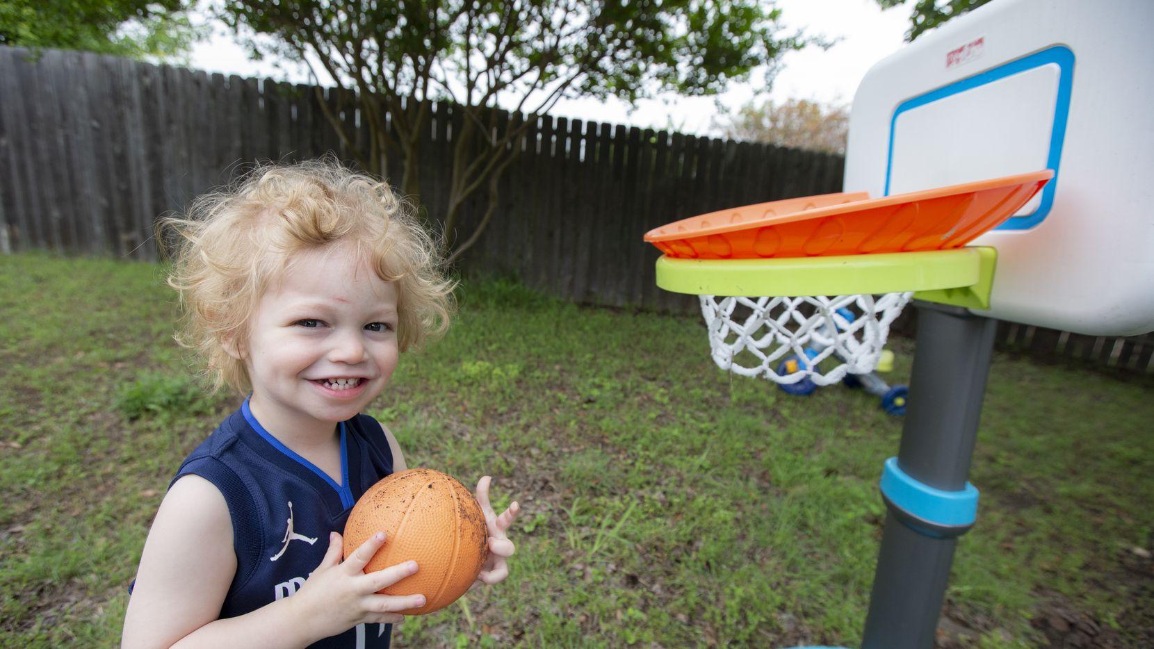 Luka Miller, 2, named after Dallas Mavericks' guard Luka Doncic, plays basketball in his backyard at his home in Glenn Heights, Thursday, May 13, 2021.(Brandon Wade/Special Contributor)