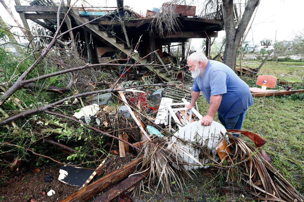 Bill Rogers surveys damage after Hurricane Harvey destroyed his house in Port Aransas, Texas on Aug. 26, 2017.   (Nathan Hunsinger/The Dallas Morning News)