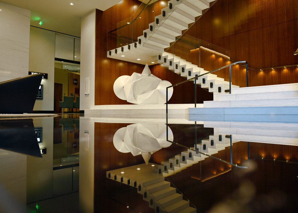 A staircase on the first floor leads to the athletic center and meeting spaces inside the newly updated Trammell Crow Center in Downtown Dallas, July 31, 2019. The staircase area used to be wall.