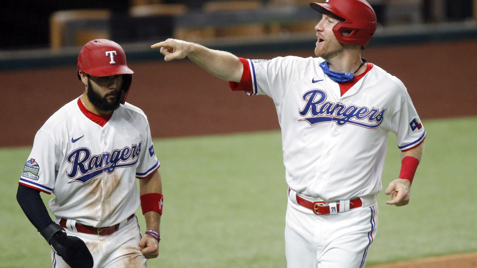 Texas Rangers Todd Frazier (right) scores with Isiah Kiner-Falefa on a single by Nick Solak in the first inning against the Seattle Mariners at Globe Life Field in Arlington, Tuesday, August 11, 2020. (Tom Fox/The Dallas Morning News)