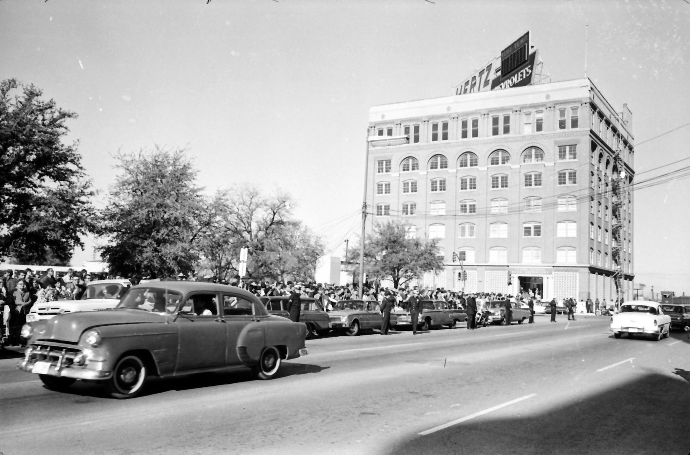 November 23, 1963 - Crowds along Houston Street waiting to see Lee Harvey Oswald transferred from city jail to county jail