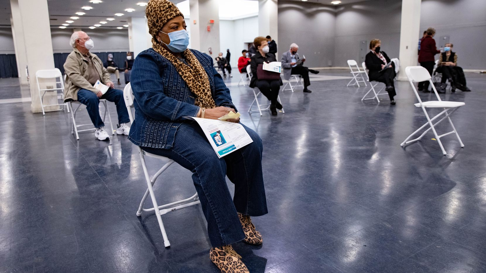 Gladys Rodgers, 77, waits after receiving the COVID-19 vaccine in the post vaccination waiting area at Fair Park in Dallas on Thursday, Jan. 14, 2021. A limited number of COVID-19 vaccine shots will be available Thursday at Fair Park for North Texans 75 and older.