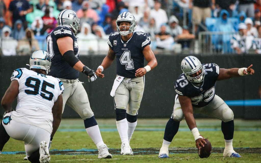 Dallas Cowboys quarterback Dak Prescott (4) calls out a play as center Joe Looney (73) prepares to hike during the Dallas Cowboys 16-8 loss to the Carolina Panthers on Sunday, Sept. 9, 2018 at Bank of America Stadium in Charlotte, North Carolina. (Ryan Michalesko/The Dallas Morning News)