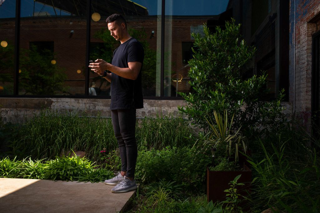 Reed Duchscher, president and founder of Night Media Co., poses for a photograph at Night Media Co. at GoodWork, a co-working space in Dallas on May 16, 2019. Night Media Co. was founded by the former sports talent management professional who created one of the first agencies to represent family-friendly YouTubers.
