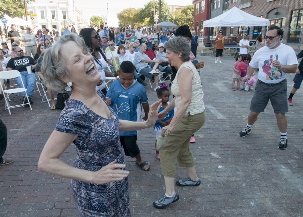 Melissa O'Neal dances the twist as Brave Combo performs in Downtown Plano.