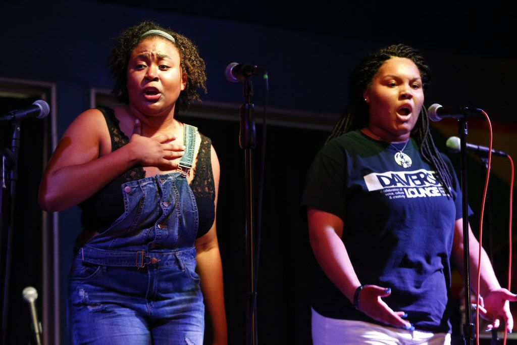 "Gabrielle Edwards, 18 (left), and Cierra Edwards, 16, perform during the Dallas Poetry Slam's ""All-Star"" slam, where notable members from Dallas' slam community, both past and present, were invited to compete."