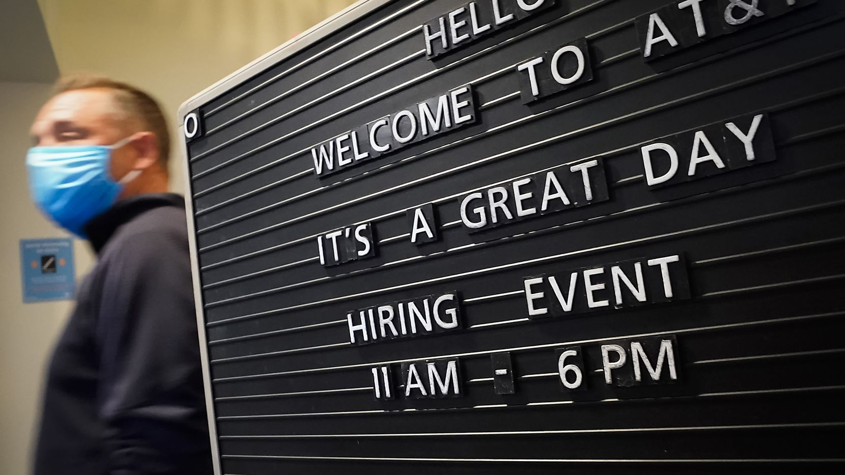 A sign welcomes job candidates to an AT&T hiring event on April 28 in Richardson. The company is hiring for 300 available jobs across the Dallas-Fort Worth area. Available positions include retail, virtual sales and customer acquisition roles.