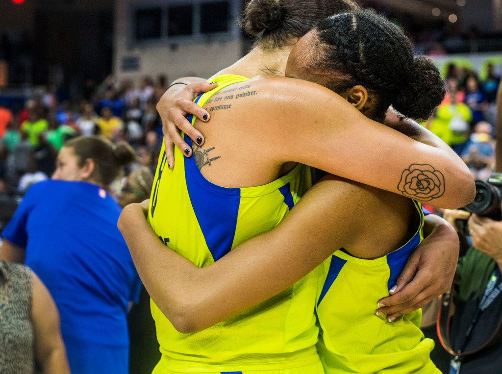 Dallas Wings center Liz Cambage (8), left, embraces forward and center Azur‡ Stevens (30) after the game against the Las Vegas Aces at College Park Center in Arlington, Texas on Aug. 17, 2018. The Wings defeated the Aces, 107-102. (Carly Geraci/The Dallas Morning News)