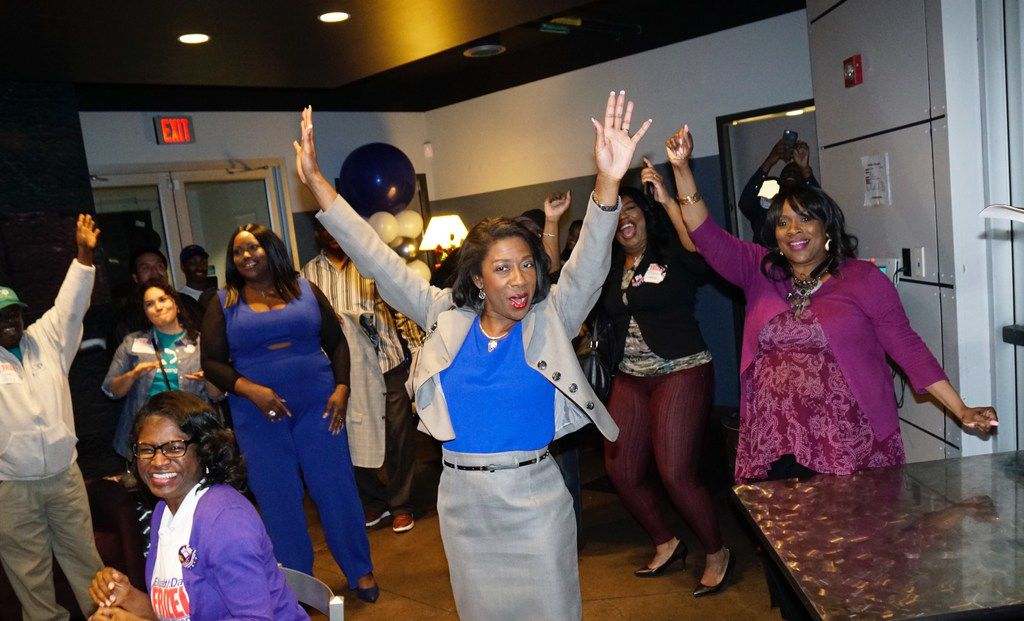 District attorney candidate Elizabeth Frizell celebrates with supporters at Delta Charlie's Bar & Grill in Dallas on primary election night.