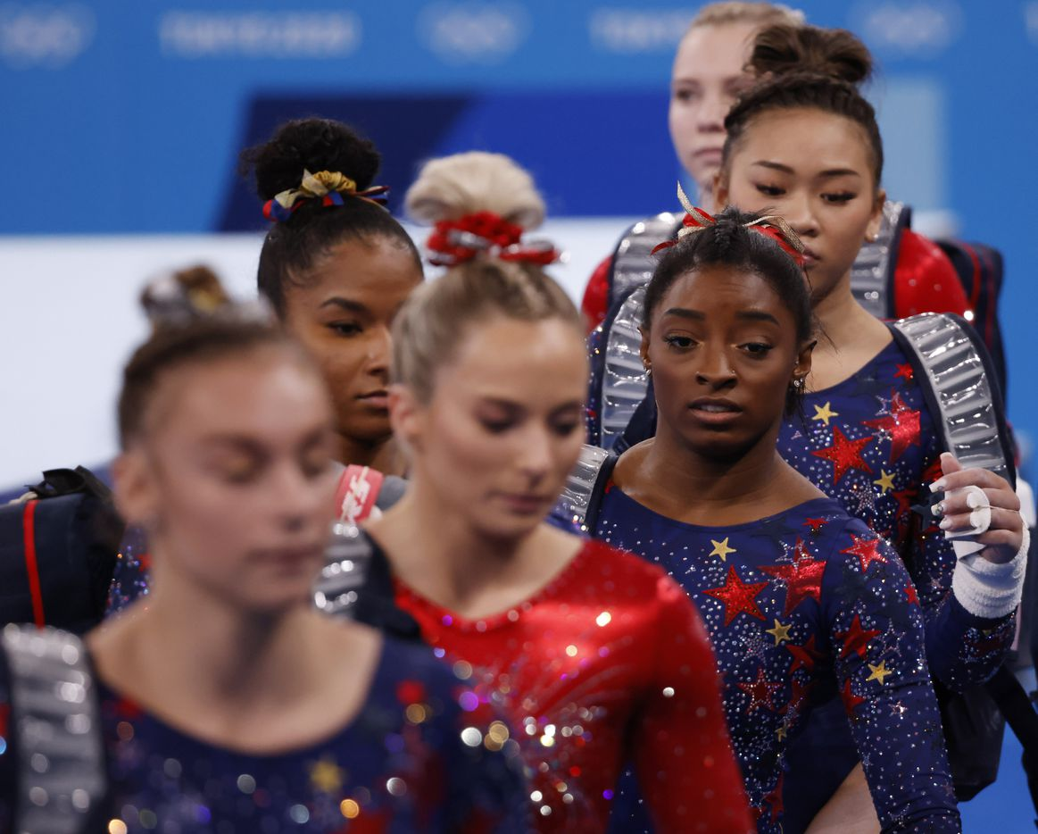 USA's Simone Biles and teammates make their way to the uneven bars during a women's gymnastics event during the postponed 2020 Tokyo Olympics at Ariake Gymnastics Centre on Sunday, July 25, 2021, in Tokyo, Japan. (Vernon Bryant/The Dallas Morning News)
