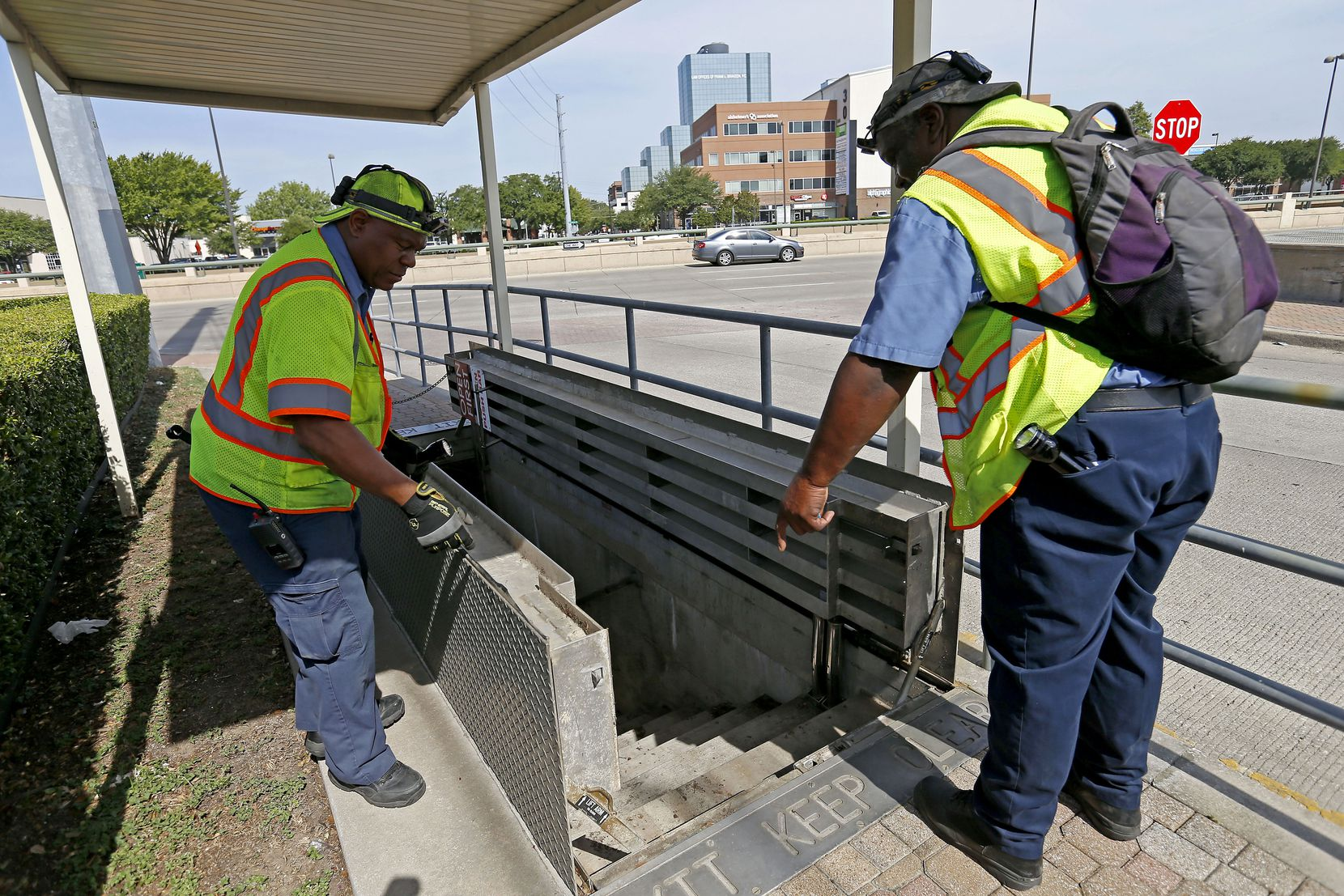 Pedestrians passing over steel plates in the sidewalk along Willis Avenue at Central Expressway might not realize that they're actually trap doors leading to a subterranean section of DART's light rail system only used by maintenance crews and as an evacuation route in case of emergency. DART mechanics Amos Hargrove (left) and Bill Lakes shut the doors after giving DMN real estate editor Steve Brown and two photographers a tour.