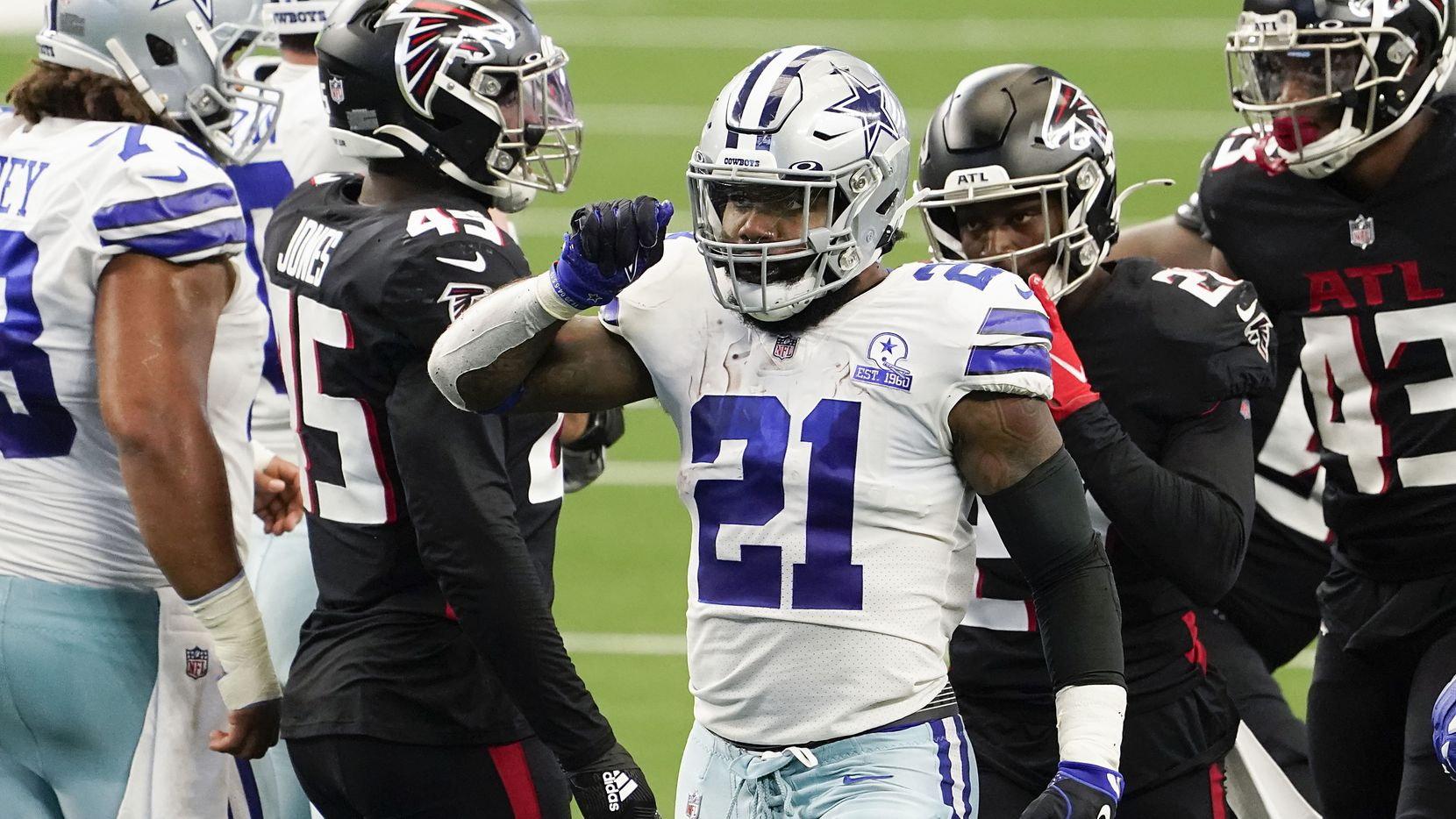 Dallas Cowboys running back Ezekiel Elliott celebrates after picking up a first down during the second quarter of an NFL football game against the Atlanta Falcons at AT&T Stadium on Sunday, Sept. 20, 2020, in Arlington.