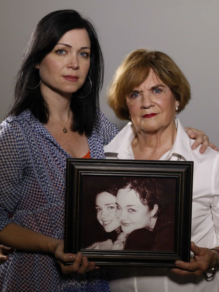 Beth Soltero (right) and her daughter Karen Soltero hold an old photograph of Karen (left) and Wendy Soltero. Wendy was murdered in Los Angeles in 2000.